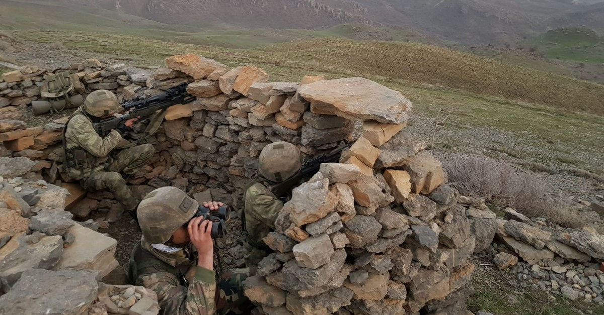Turkish soldiers keep watch near the Turkey-Iraq border in this undated handout photo. (AA Photo)