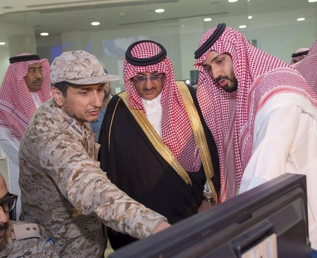 Defence Min. Prince Mohammad bin Salman (R) and Interior Min. and Deputy Crown Prince Mohammed bin Nayef are briefed by officers on the military operations in Yemen.