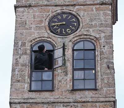 Zlatar checks the clock face on the tower's exterior. (AA Photo)