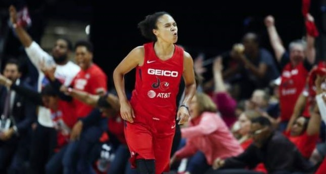 Washington Mystics guard Kristi Toliver celebrates after her 3-point basket during the first half of Game 5 of basketball's WNBA Finals against the Connecticut Sun in Washington, Oct. 10, 2019. Toliver is also an assistant coach with the Washington Wizards. (AP Photo)