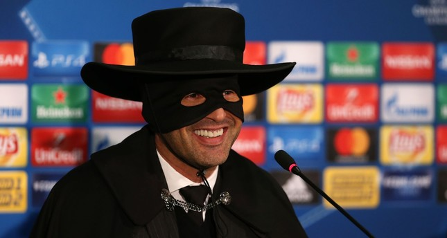 Shakhtar Donetsk's manager Paulo Fonseca, wearing a Zorro mask and hat, delivers a press conference after Shakhtar Donetsk won their UEFA Champions League group F football match against Manchester City. (AFP Photo)