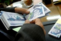 Iran's central bank proposes removing 4 zeros from plunging rial