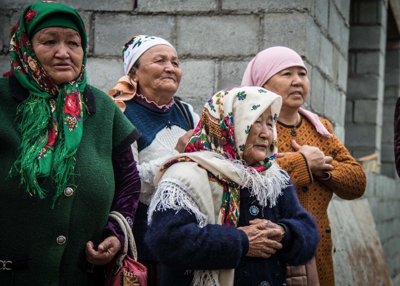 Meskhetian women accept help from Turkey and Turkish nongovernmental organizations with tears in their eyes.