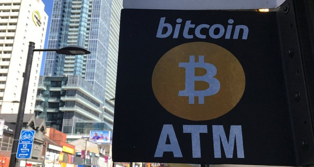 A sign seen outside a business where a Bitcoin ATM is located in Toronto, Canada.