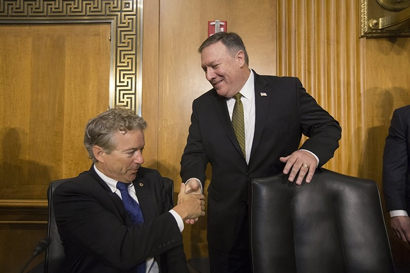 Republican Senator from Kentucky Rand Paul (L) shakes hands with CIA Director Mike Pompeo (R) before the Senate Foreign Relations Committee hearing on the nomination of Pompeo to be Secretary of State, in Washington D.C., April 12, 2018. (EPA Photo)
