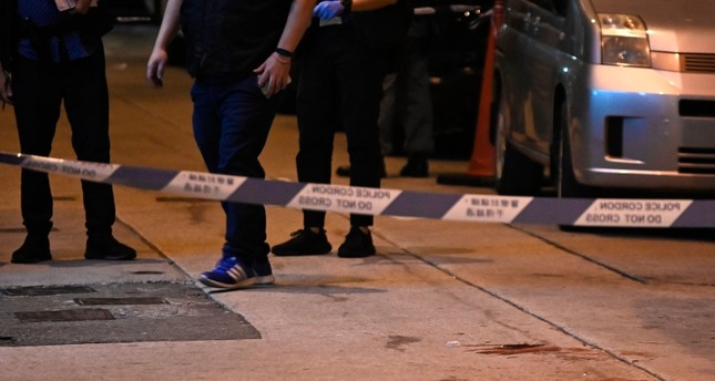 Blood is seen beyond a police cordon, where Jimmy Sham, convener of the Civil Human Rights Front (CHRF), was assaulted by four to five people wielding hammers in the Mongkok district of Kowloon in Hong Kong on October 16, 2019. (AFP Photo)
