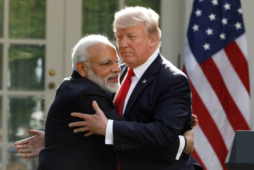 India's Prime Minister Narendra Modi hugs U.S. President Donald Trump as they give joint statements in the Rose Garden of the White House.