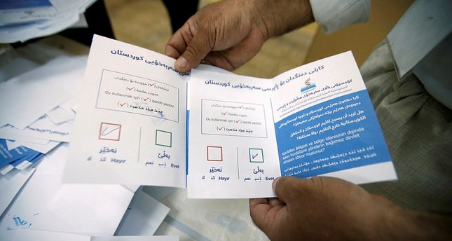 Officials sort ballot papers after the close of the polling station during Kurds independence referendum in Erbil, Iraq September 25, 2017. (REUTERS Photo)