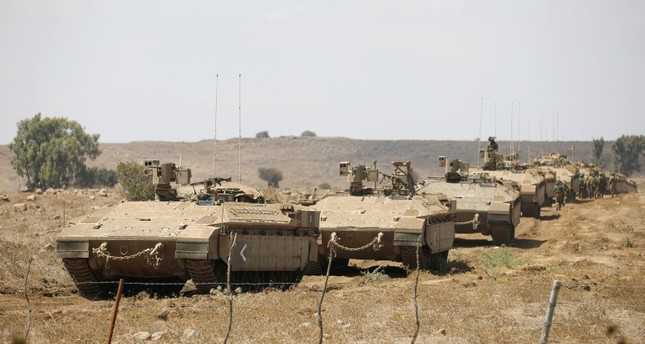 Israeli armored vehicles take part in an army drill in the Israeli-occupied Golan Heights, Aug. 7, 2018. (Reuters Photo)