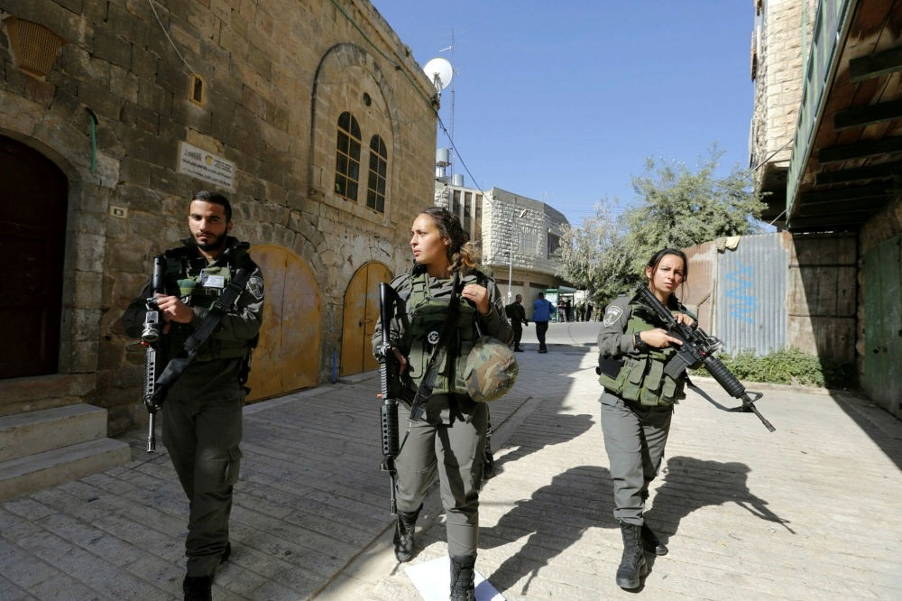 Armed Israeli border police officers, in the old city of Hebron, West Bank, May 4.