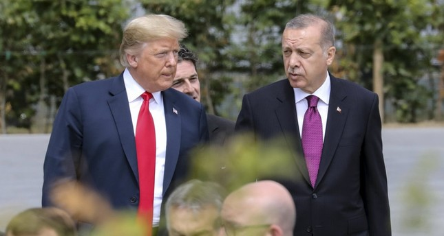 U.S. President Donald Trump (L) speaks with President Recep Tayyip Erdoğan (R) ahead of the opening ceremony of the NATO summit, at the NATO headquarters in Brussels, July 11.
