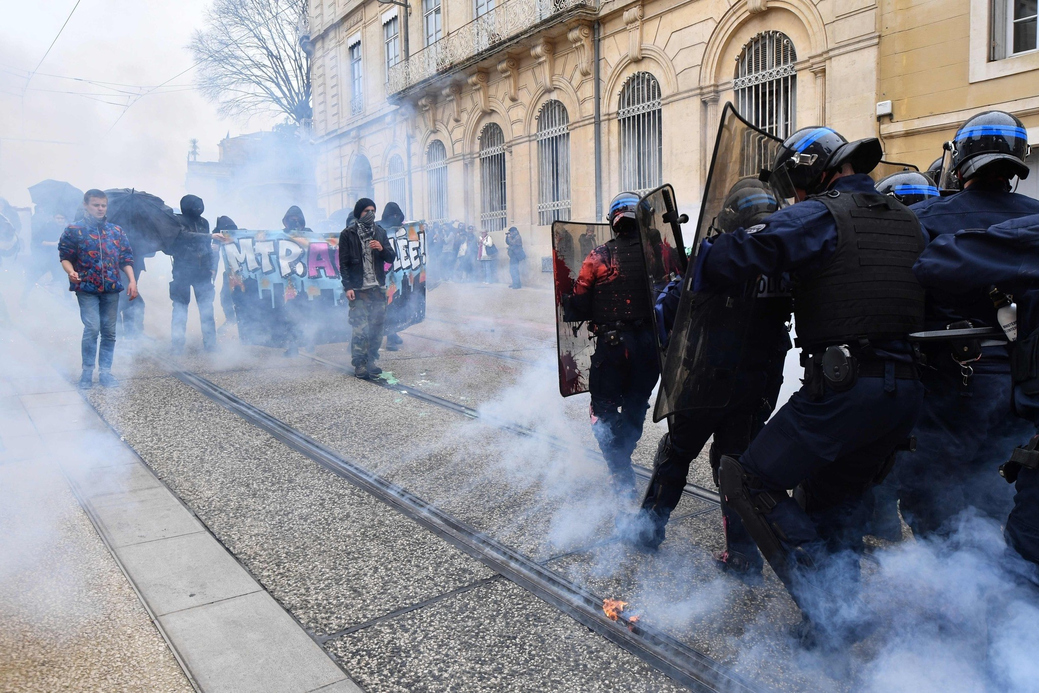 Demonstrators clash with anti-riot police officers during a student protest against the planned reforms of the French government, Montpellier, May 14.