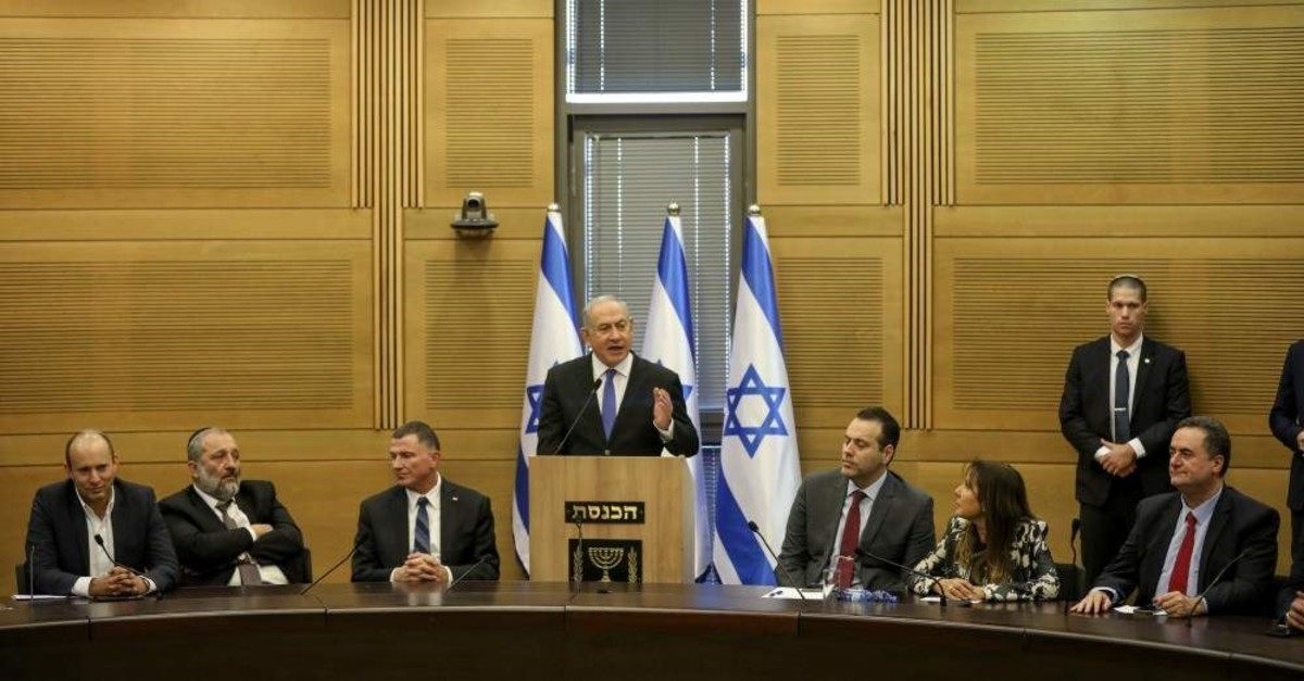 Israeli Prime Minister Benjamin Netanyahu speaks during an extended meeting of the right-wing bloc members at the Knesset, Jerusalem, Nov. 20, 2019. (AP Photo)
