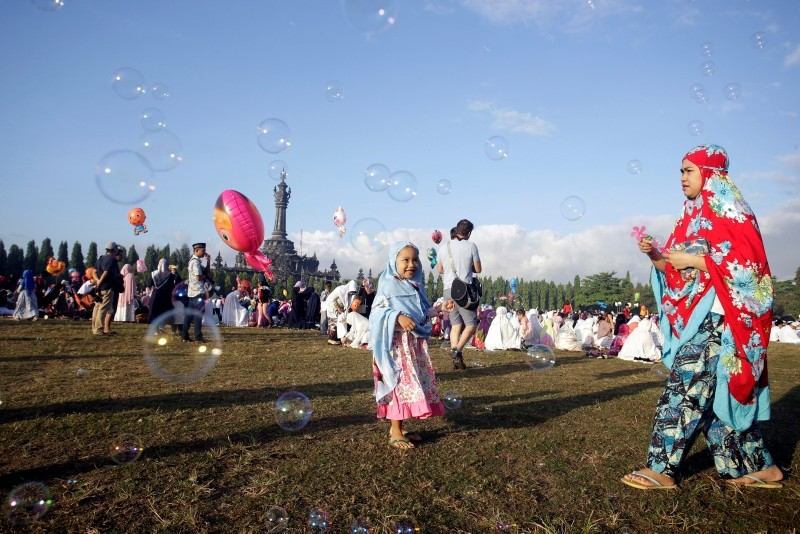 Muslims celebrate Eid, marking Ramadan's end