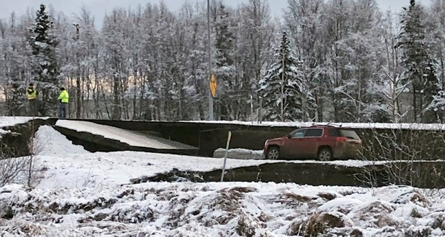A car is trapped on a collapsed section of the offramp off of Minnesota Drive in Anchorage, Friday, Nov. 30, 2018 (AP Photo)