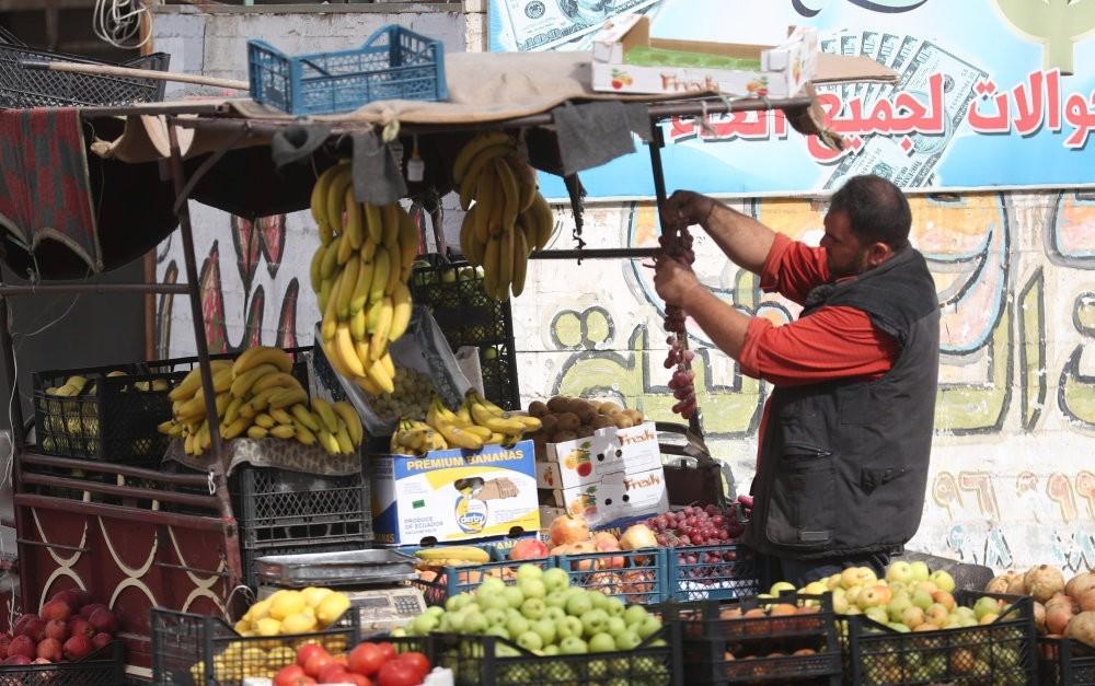 A fruit vendor sells his produce in Idlib, Oct. 15.