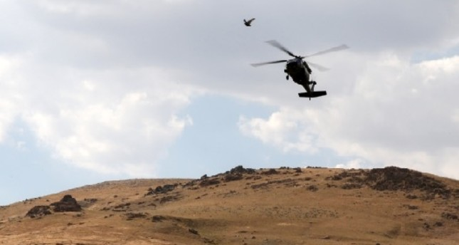 A Turkish military helicopter seen during a large-scale operation against the PKK terrorist organization in the mountainous areas of a district of southern Van province, Aug. 21, 2019.