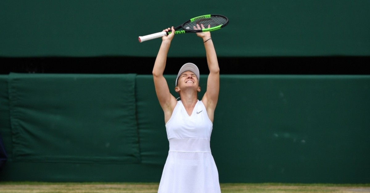 Romania's Simona Halep celebrates beating US player Serena Williams during their women's singles final on day twelve of the 2019 Wimbledon Championships at The All England Lawn Tennis Club in Wimbledon, southwest London, on July 13, 2019. (AFP Photo)