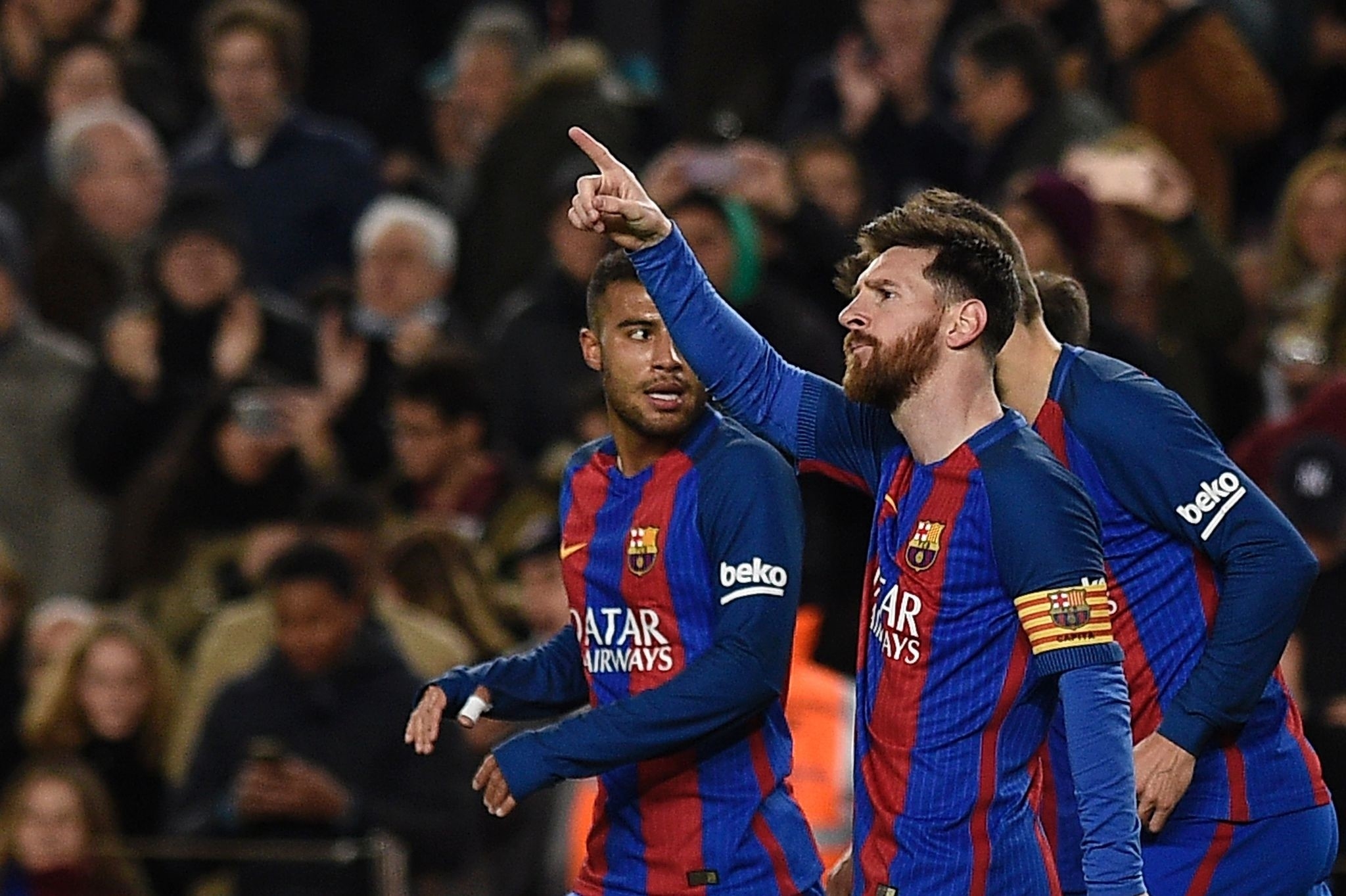 Barcelonau2019s Argentinian forward Lionel Messi celebrates after scoring a goal during the Spanish league football match Barcelona vs Celta Vigo at the Camp Nou stadium.