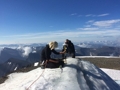 A handout picture released by Stockholm University on Aug. 1, 2018, and taken on July 31, 2018, shows Gunhild Ninis Rosqvist, a Stockholm University geography professor making measurements atop Sweden's highest peak, a glacier on the southern tip of the Kebnekaise mountain in northern Sweden. (AFP Photo)