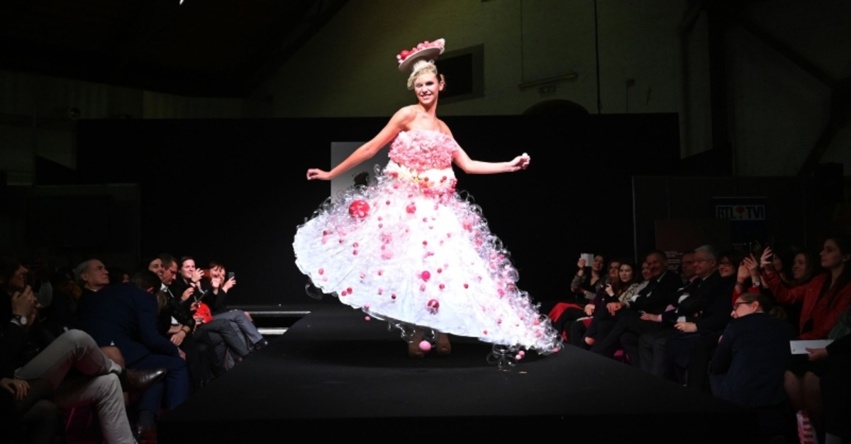 A model presents a chocolate-made dress creation during a fashion show of clothes made out of chocolate for the inaugural night of the sixth Chocolate Fair in Brussels, on February 21, 2019. (AFP Photo)