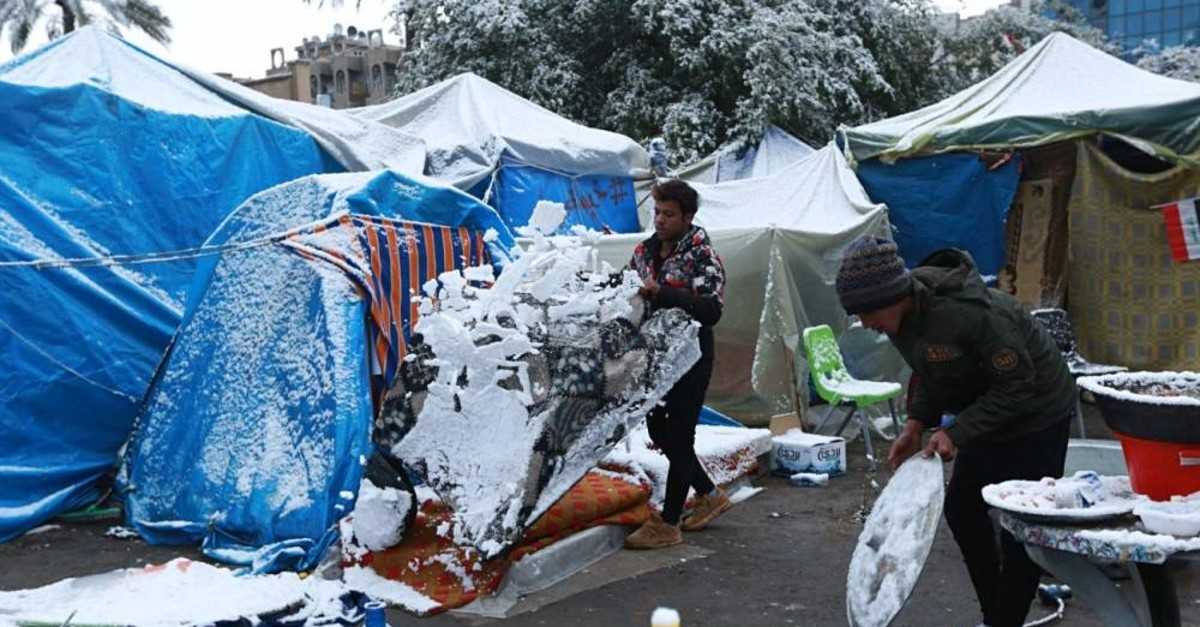 Fresh snow falls in Tahrir Square while anti-government protesters stage a sit-in, Baghdad, Feb. 11, 2020. (AP Photo)