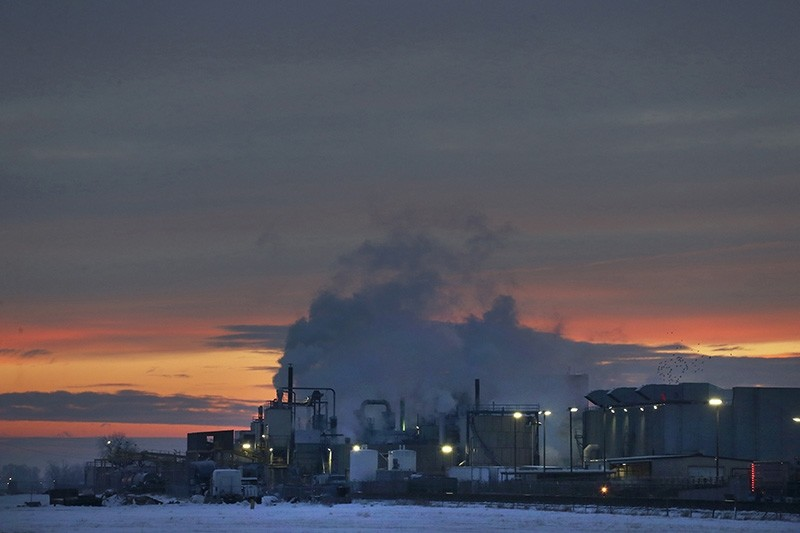 In this Jan. 11, 2016 file photo, dawn approaches over the meat processing plant owned and run by Cargill Meat Solutions, in Fort Morgan, a small town on the eastern plains of Colorado. (AP Photo)