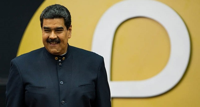 Venezuelan President Nicolas Maduro during a press conference with the new Venezuelan cryptocurrency 'petro' logo in the background in Caracas, Venezuela, March 22, 2018. EPA Photo