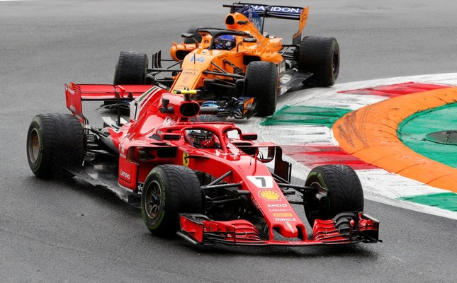 Ferrari's Kimi Raikkonen and McLaren's Fernando Alonso during practice in Monza, Aug. 31.
