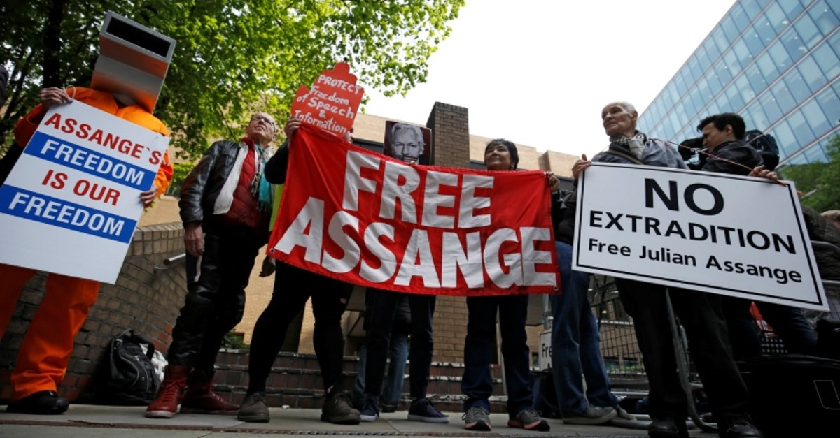 People hold signs during a protest outside Southwark Crown Court where WikiLeaks founder Julian Assange will be sentenced, in London, Britain, May 1, 2019. (Reuters Photo)