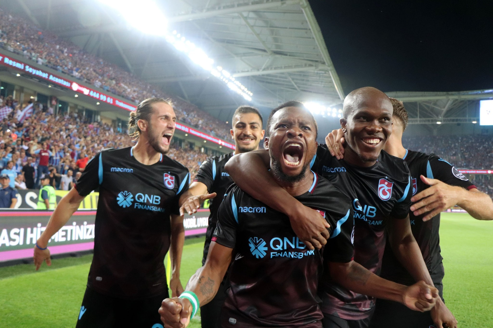 Trabzonspor players celebrate 4-0 win against Galatasaray on Saturday in front of their fans.