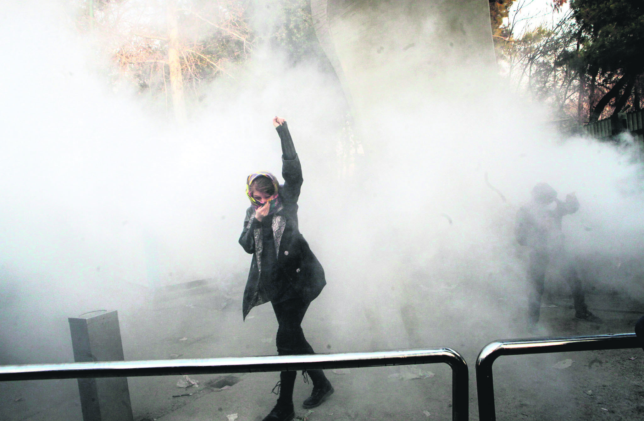 Iranian students clash with riot police during an anti-government protest around the University of Tehran, Iran, Dec. 30.