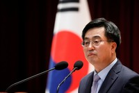 South Korean President Moon fires finance minister, policy chief