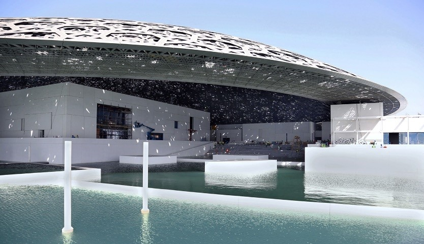 Abu Dhabiu2019s Louvre museum, designed by French architect Jean Nouvel, surrounded by sea water.