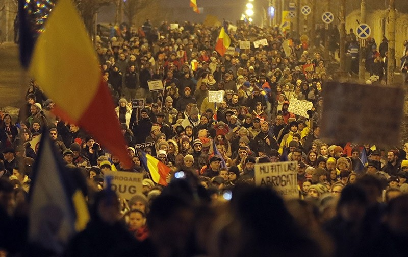 Demonstrators march in front of the government building during a protest in Bucharest, Romania, Saturday, Feb. 4, 2017. (AP Photo)