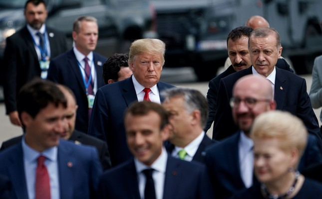U.S. President Trump (L) and President Recep Tayyip Erdoğan (R) walk behind the other NATO leaders during NATO's Brussels meeting on July 11.
