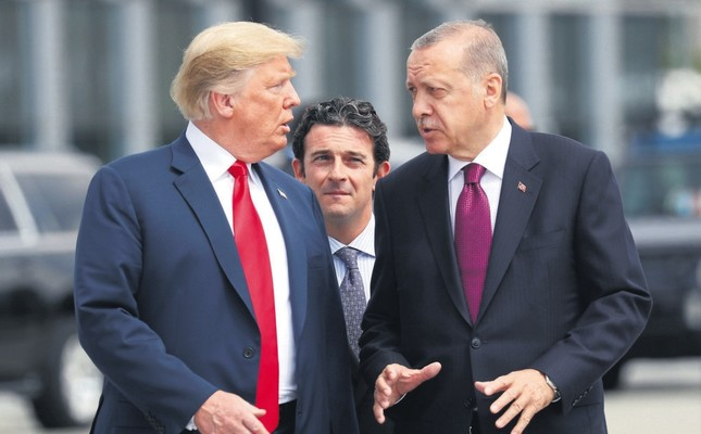 President Recep Tayyip Erdoğan and U.S. President Donald Trump L talk as they walk during the start of the NATO summit in Brussels, Belgium, July 11, 2018.