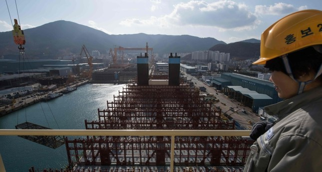 A view of the deck of an under-construction Maersk triple-E class container ship at the Daewoo DSME shipyard in Okpo.
