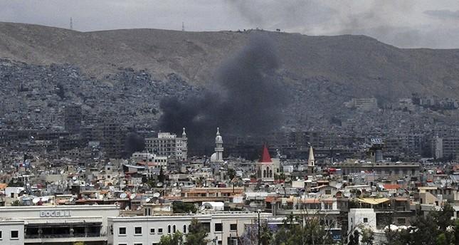 صورة نشرتها وكالة النظام السوري الرسمية للدخان يتصاعد من مكان الانفحار في جمشق