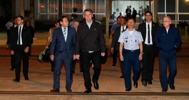 Brazil's President Jair Bolsonaro walks before his trip to Japan for this week's G20 meeting at the Air base in Brasilia, Brazil June 25, 2019. (Reuters Photo)