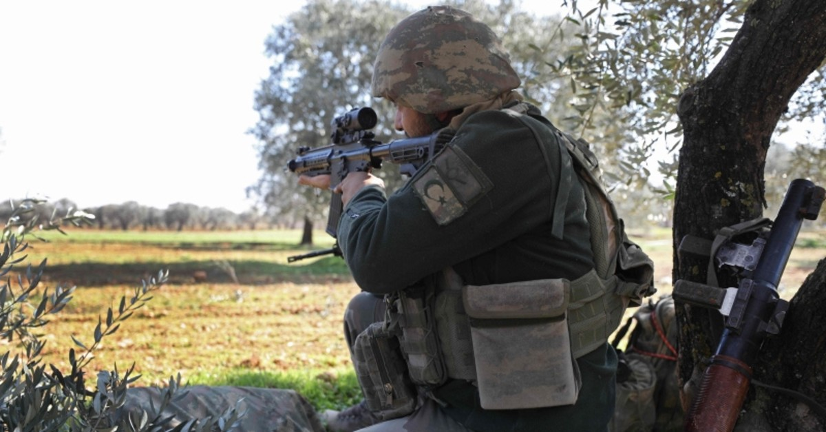 A Turkish soldier aims his rifle at a position near the village of Nairab, about 10 kilometers southeast of the city of Idlib in northwestern Syria, on February 20, 2020. (AFP Photo)