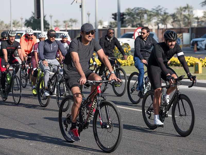 Emir of Qatar, Sheikh Tamim bin Hamad Al Thani him touring on a bicycle among a group of young riders. (AA Photo)
