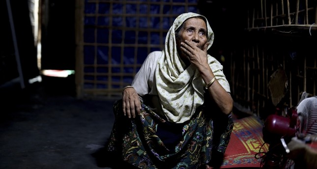 An elderly Rohingya refugee sits inside a family shelter in Kutupalong refugee camp, Bangladesh, Aug. 28.