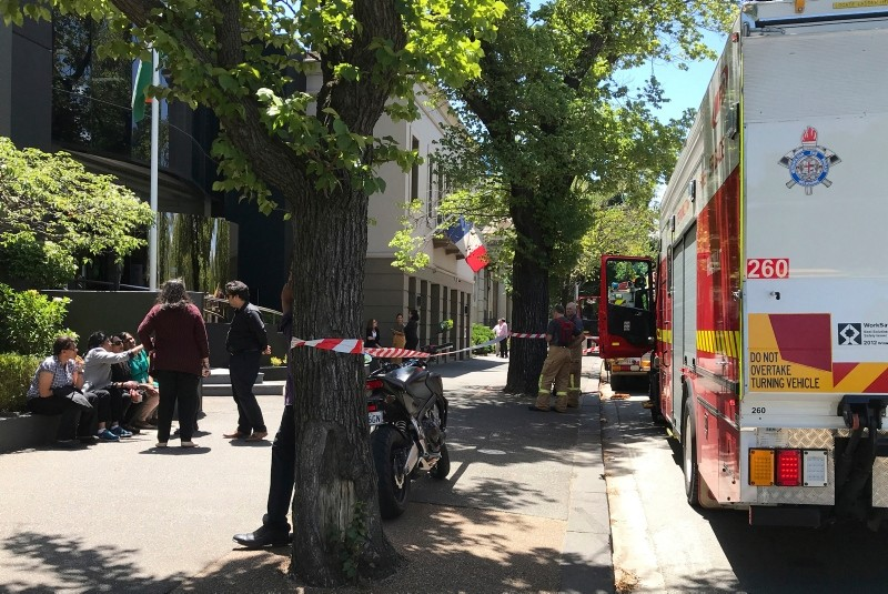 Firefighters, right, are seen outside the Indian and French consulates on St Kilda Road in Melbourne, Wednesday, Jan. 9, 2019 (AP Photo)
