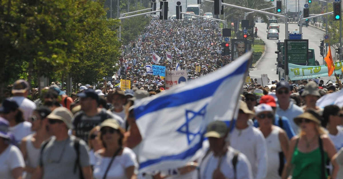 The family of abducted Israeli soldier Gilad Shalit and thousands of supporters march in Tel Aviv on July 5, 2010, on the 9th day of a 200-kilometre (120-mile) solemn protest march (AFP File Photo)