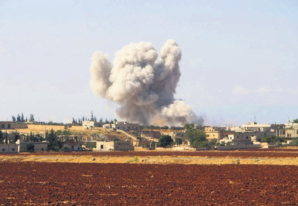 Smoke rises after an airstrike by the Syrian regime in Idlib, Sept. 10.