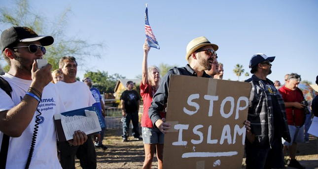 More than 200 protesters, some armed, outside a mosque in Arizona Phoenix, berating Islam and Prophet Muhammad (Peace Be Upon Him).