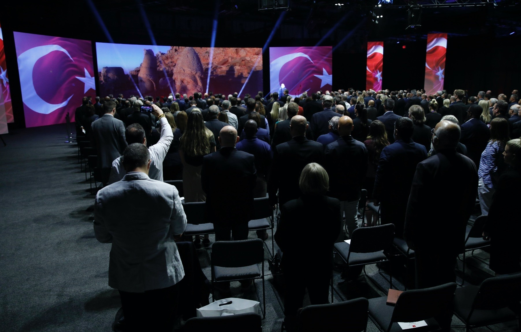 Attendees rise to their feet to applaud during the ceremony marking the delivery of F-35 jets to Turkey at Lockheed Martinu2019s facilities, June 21, Fort Worth, Texas.