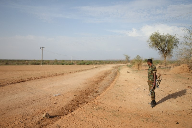 An Ethiopian military officer stands guard in the outskirts of Badme, a territorial dispute town between Eritrea and Ethiopia currently occupied by Ethiopia June 8, 2018. (Reuters Photo)
