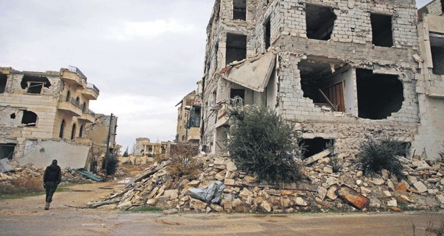A view of a building damaged by Russian airstrikes in the Syrian opposition-held al-Rashidin district of western Aleppo, Nov. 26.
